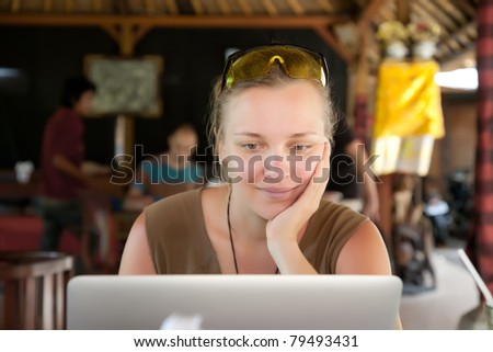 Beautiful woman with laptop in street cafe