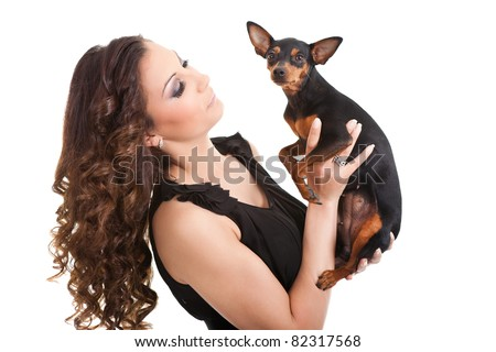 beautiful woman with little dog, black miniature pincher, isolated on white - stock photo
