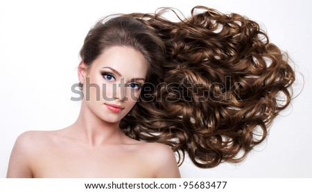 Beautiful woman with long beauty hairs - on  white background - stock photo