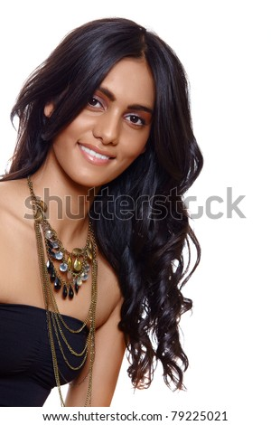beautiful woman with long black curly hair, tanned skin and natural make-up over white background - stock photo