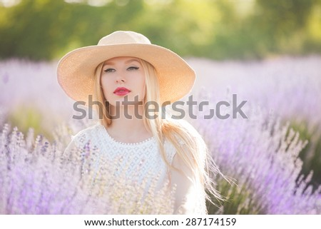 beautiful woman with  long blond hair in the lavender field