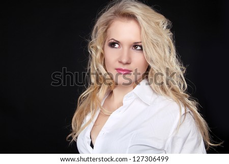 Beautiful woman with long blond hair isolated on black background