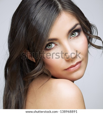 Beautiful woman with long brown hair. Female model studio portrait.