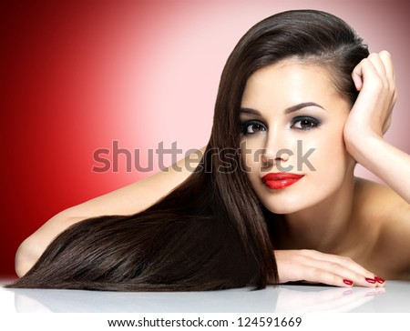 Beautiful woman with long brown straight hairs - isolated on white background - stock photo