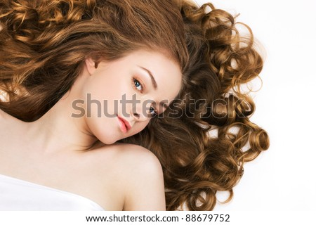 Beautiful woman with long curly hair - stock photo