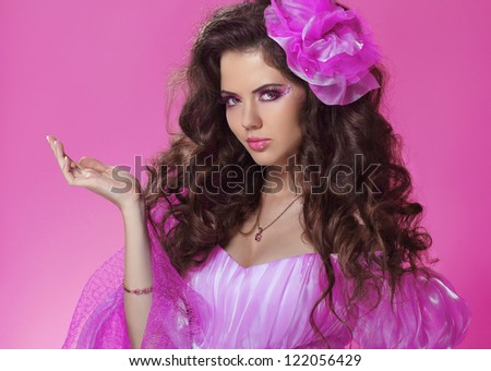 Beautiful woman with long curly hair style over pink - stock photo