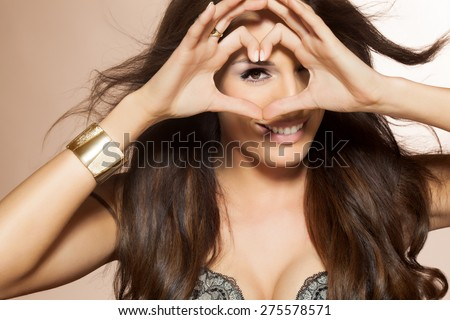 Beautiful woman with long dark hair. Beauty and fashion concept in studio. Shiny locks of groomed hair. - stock photo