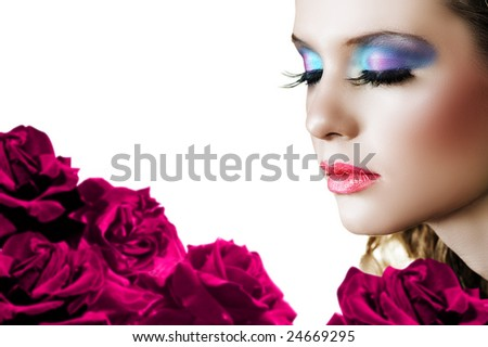 Beautiful woman with long false lashes and bright make-up on red rose background ? shallow DOF, focus on the face - stock photo