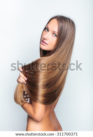beautiful woman with long hair - stock photo