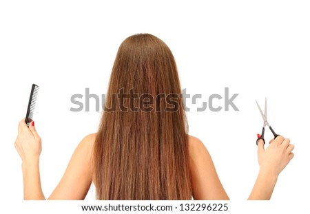Beautiful woman with long hair and hairdresser's  tools, isolated on white