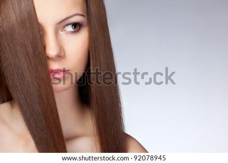 beautiful woman with long hair, closeup face. Studio portrait - stock photo