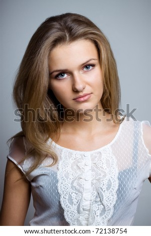 Beautiful woman with long hair in lase shirt. Studio shot - stock photo
