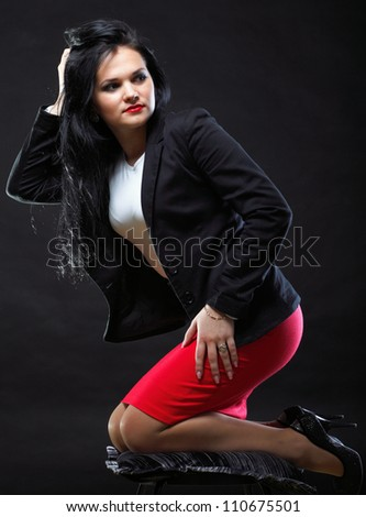 beautiful woman with long hair posing ion black background - stock photo