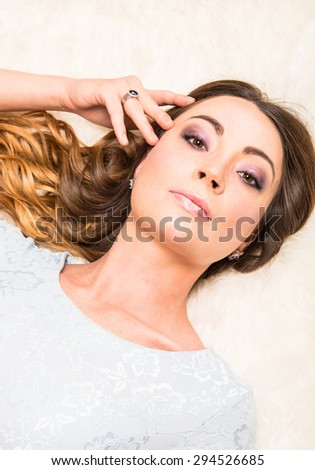 Beautiful woman with long healthy hair and jewelry