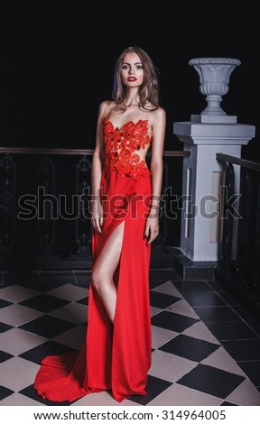 Beautiful woman with long legs in red dress - stock photo
