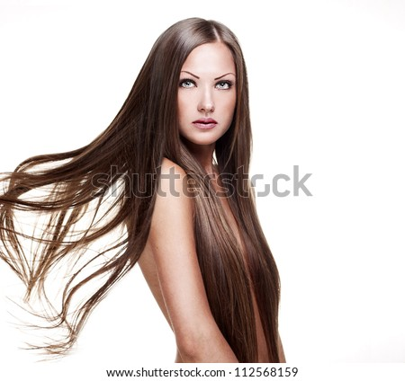 beautiful woman with long natural shiny healthy hair ,isolated on white background - stock photo