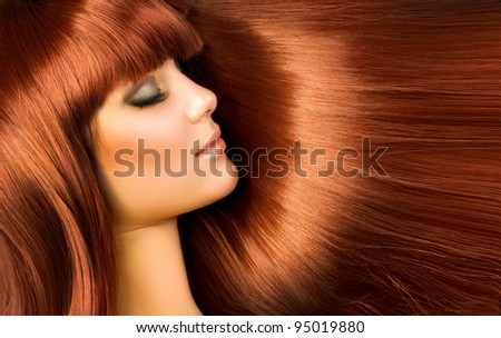 Beautiful Woman with Long Red Hair - stock photo
