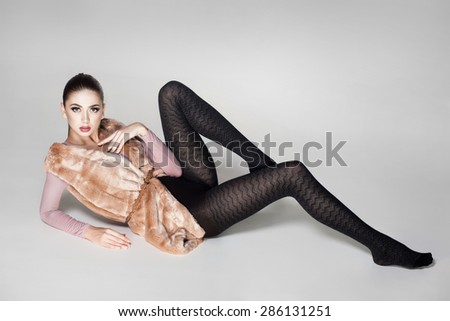 beautiful woman with long sexy legs dressed elegant posing