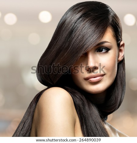 Beautiful woman with long straight hair. Fashion model posing  - stock photo