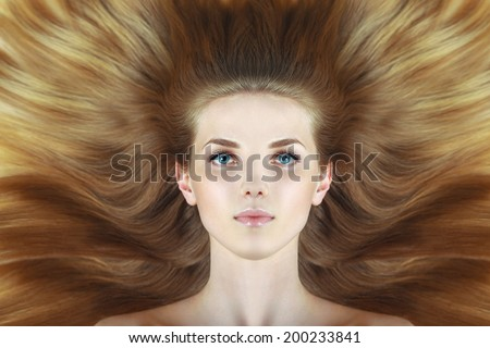 Beautiful woman with long wave blond hairs. Blue eyes. fashion creative studio photoshoot. - stock photo