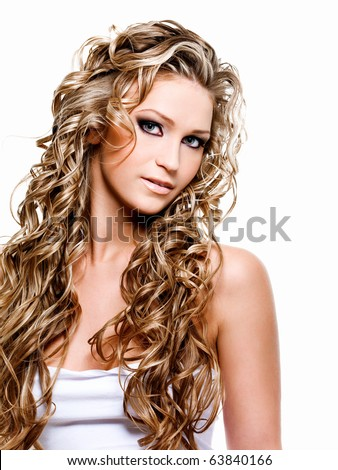 Beautiful woman with luxury blond long curly hair - stock photo