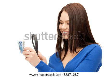 beautiful woman with magnifying glass and euro cash money - stock photo