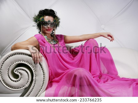 Beautiful   woman with mask. Carnaval visage. - stock photo