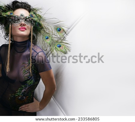 beautiful woman with mask in night club  - stock photo