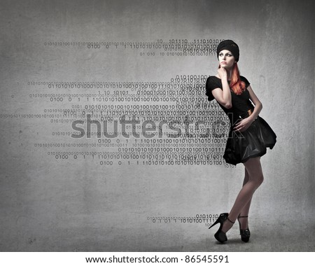 Beautiful woman with numbers coming out from her clothes - stock photo