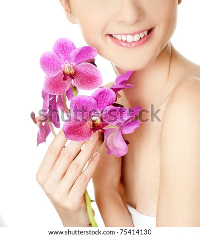 Beautiful woman with orchid flower - stock photo