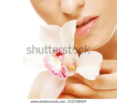 Beautiful woman with orchid flower, isolated on white - stock photo