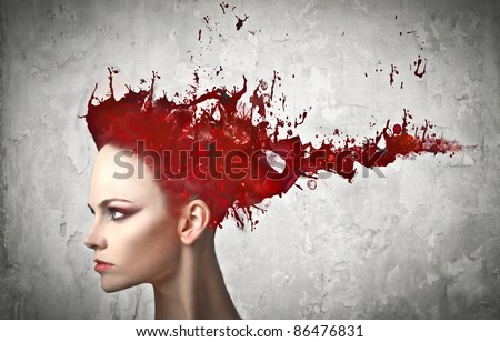 Beautiful woman with paint instead of her hair - stock photo