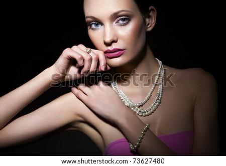 Beautiful woman with pearl jewelry - stock photo