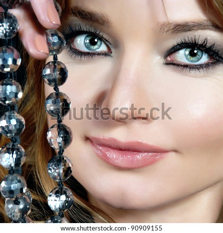 Beautiful woman with pearl jewelry - stock photo