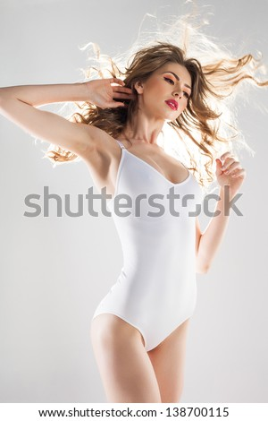 beautiful woman with perfect body dressed in white body-wear - stock photo