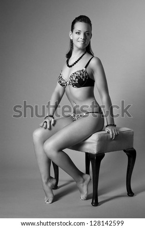 beautiful woman with perfect body posing with lingerie - stock photo