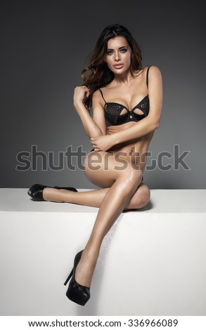 Beautiful woman with perfect body wearing black lingerie  - stock photo