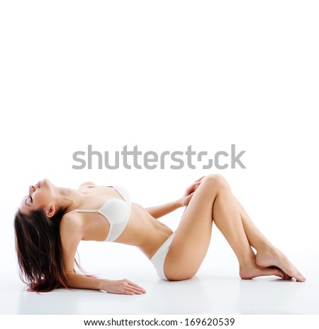 Beautiful woman with perfect figure in white underwear - stock photo