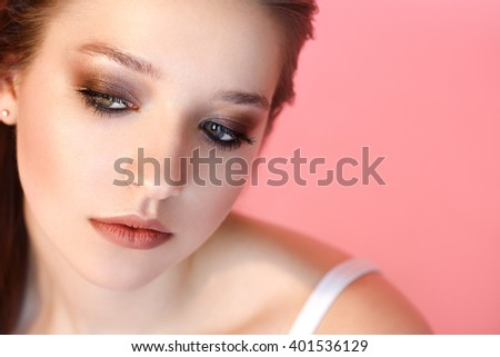 Beautiful woman with perfect make-up and hairstyle on pink background - stock photo