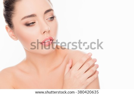 Beautiful  woman  with perfect skin touching her shoulder, close up portrait - stock photo