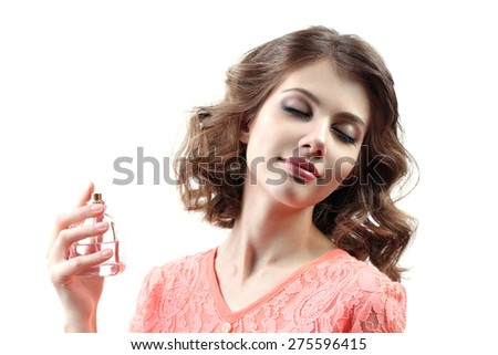 Beautiful woman with perfume bottle isolated on white - stock photo