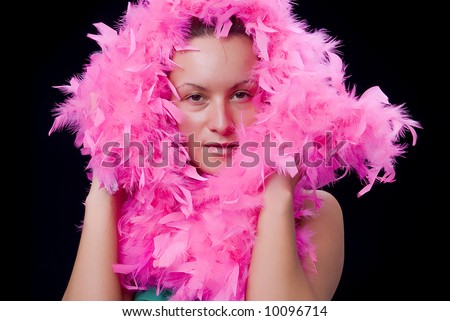 Beautiful woman with pink feather boa