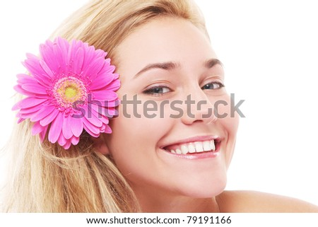Beautiful woman with pink flower in her hairs isolated over white background