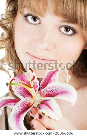 Beautiful woman with pink lily over white - stock photo