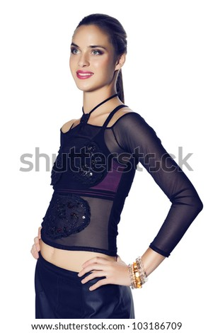 beautiful woman with pink lipstick wearing a mesh fashion top and a leather black skirt on white background.