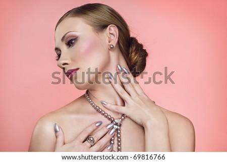 Beautiful woman with pink pearl jewelry - stock photo