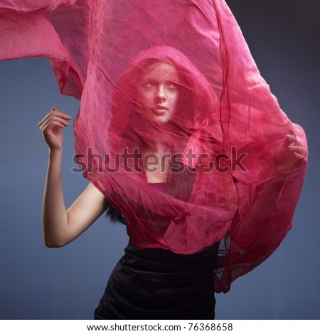 Beautiful woman with pink waving flying scarf - stock photo