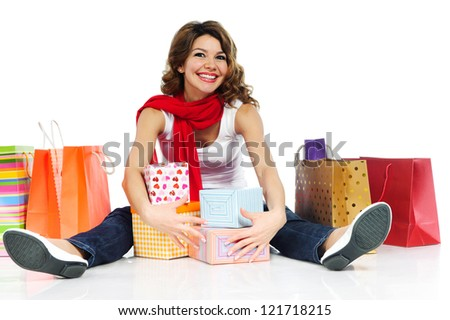 Beautiful woman with present boxes and shopping bags isolated on white background