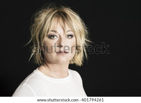 Beautiful Woman with Professional Hair & Makeup in Studio.