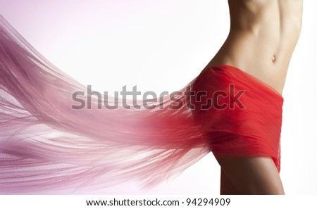 Beautiful woman with rad tissue on her hips melting in red liquid - stock photo